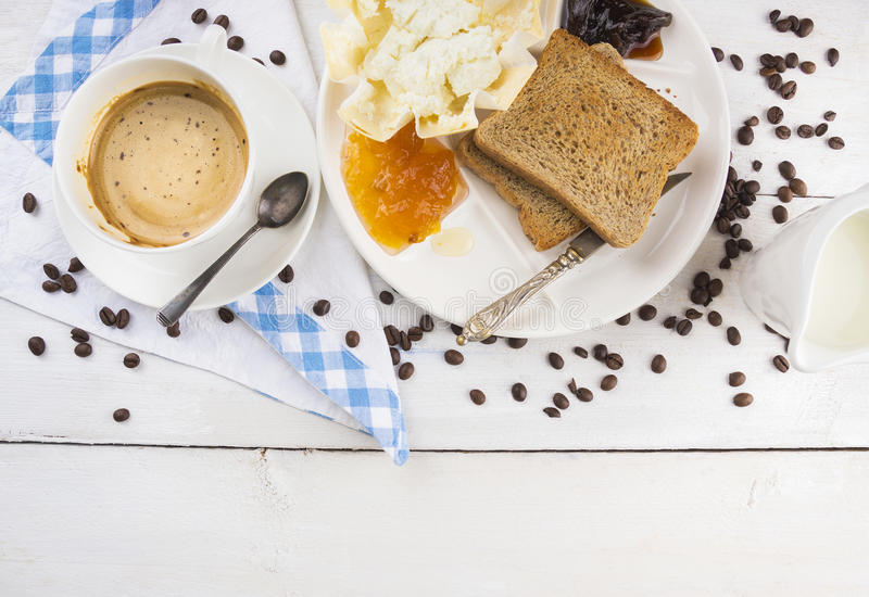 Breakfast with coffee and toast on white wooden table. Top view, copy space stock photo