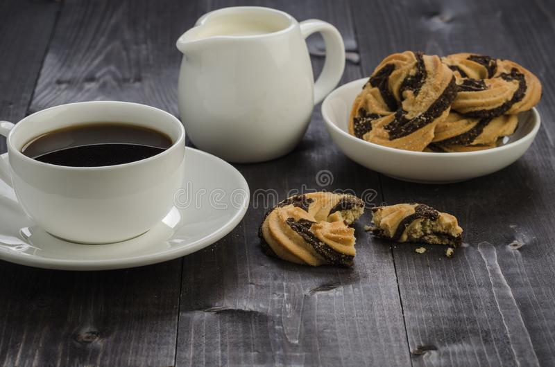 breakfast with cookies, cup of coffee and cream/breakfast with cookies, cup of coffee and cream on a dark wooden background royalty free stock photos