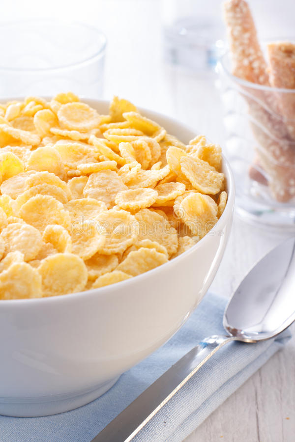 Breakfast of cornflakes on a wooden background. A healthy breakfast of cornflakes on a background of a wooden table stock image