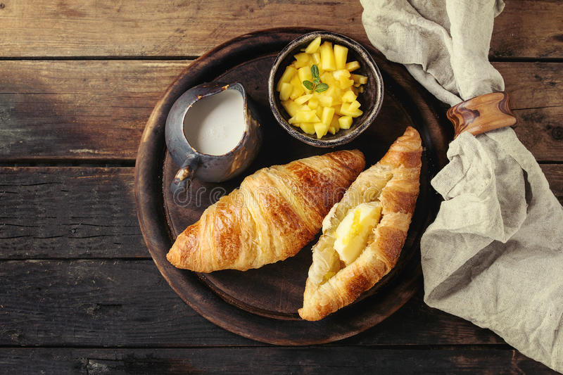 Breakfast with croissant and mango fruit stock photos