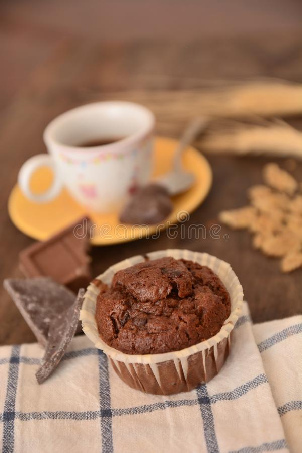 Breakfast cup coffe espresso black cereals muffin milk chocolate pieces on table morning food royalty free stock image
