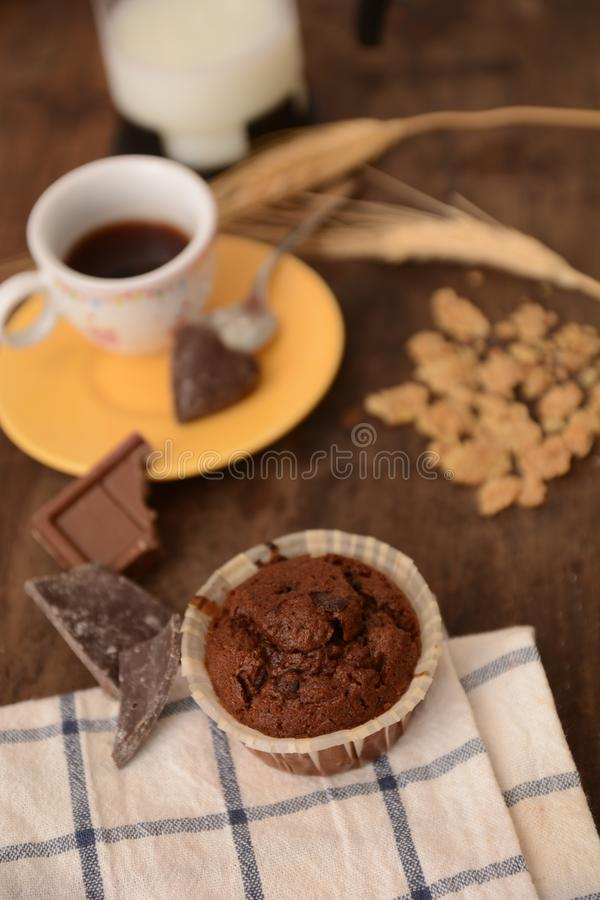 Breakfast cup coffe espresso black cereals muffin milk chocolate pieces on table morning food royalty free stock photo