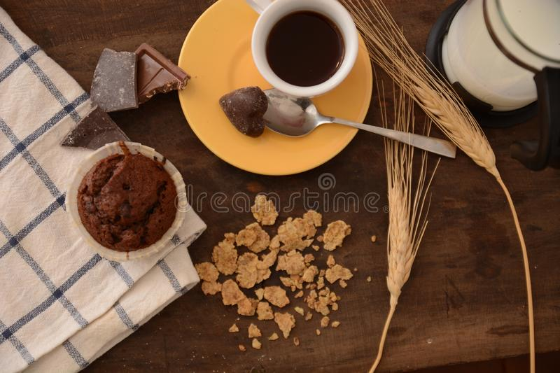 Breakfast cup coffe espresso black cereals muffin milk chocolate pieces on table morning food stock photography
