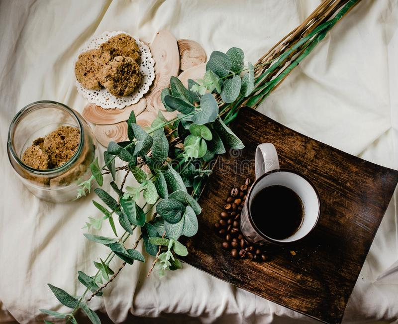 Breakfast. A cup of coffee with biscotti with peanut butter in a royalty free stock image