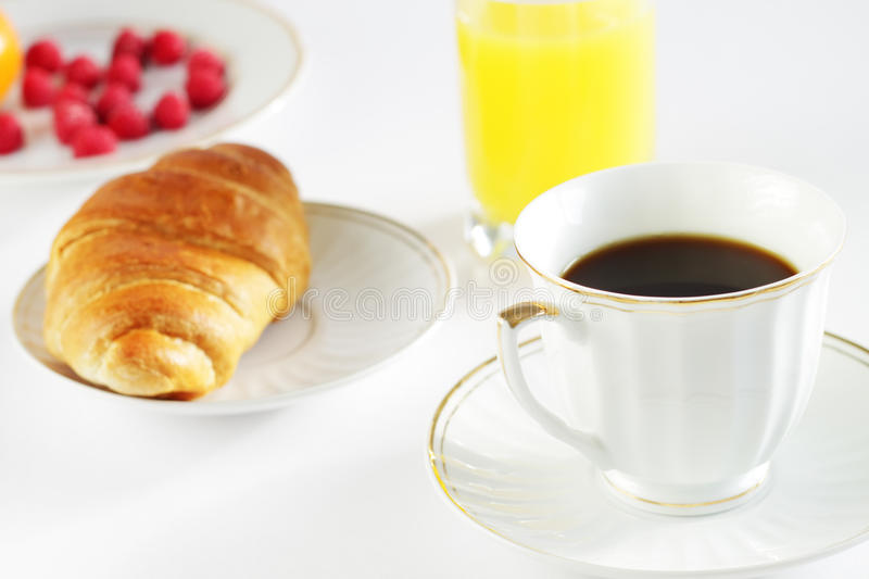 Breakfast. A cup of coffee and croissant stock photos