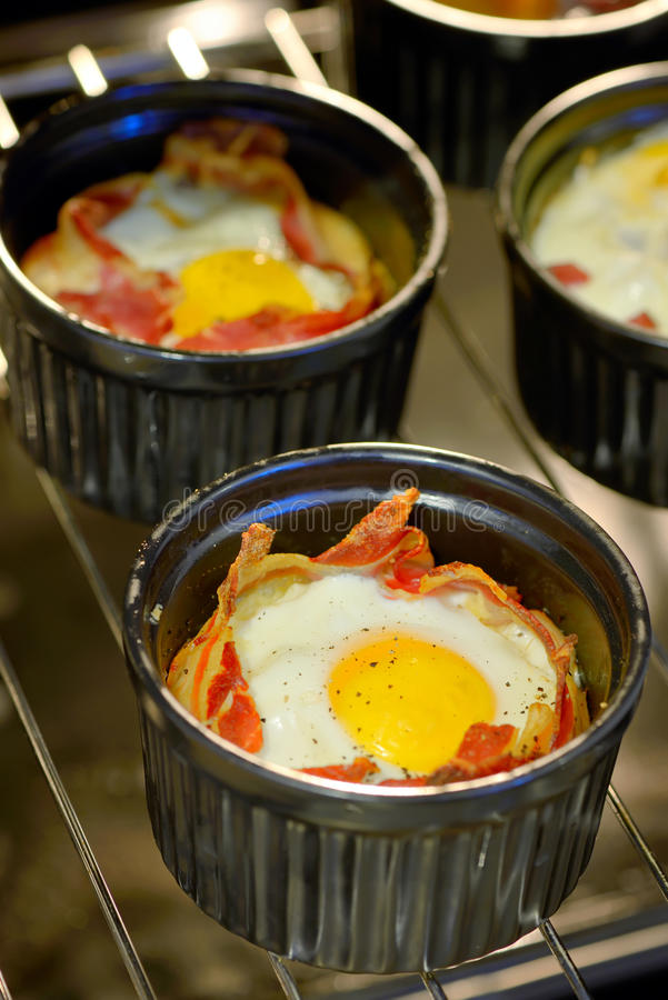 Breakfast cups egg with bacon. Menu breakfast cups egg with bacon royalty free stock image