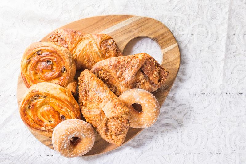 Breakfast with different French Pastries. Such as Almond Croissants, Donuts and Pain Au Raisins stock images