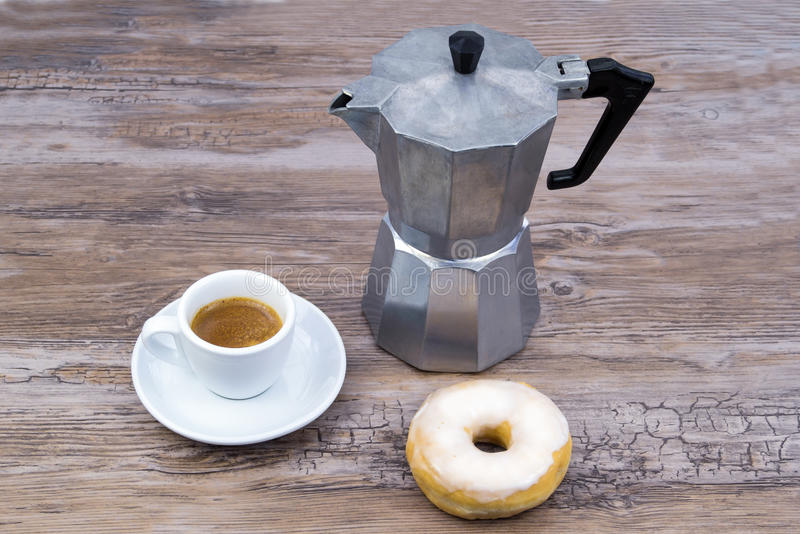 Breakfast with donut and coffee royalty free stock photo