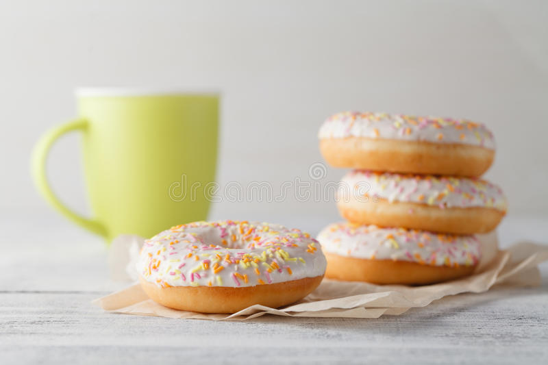 Breakfast with donuts and bug mug of coffee royalty free stock photo