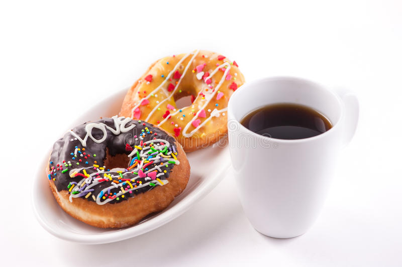 Breakfast with donuts. And coffee isolated on white background stock photo