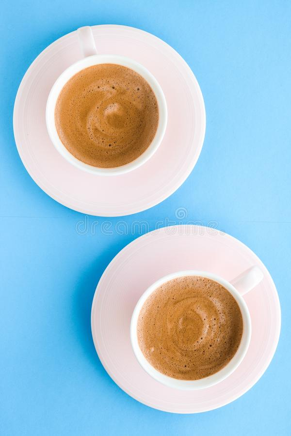 Hot aromatic coffee on blue background, flatlay. Breakfast, drinks and modern lifestyle concept - Hot aromatic coffee on blue background, flatlay stock photo