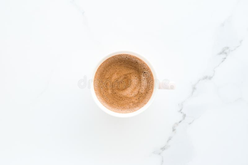 Hot aromatic coffee on marble, flatlay. Breakfast, drinks and modern lifestyle concept - Hot aromatic coffee on marble, flatlay royalty free stock images