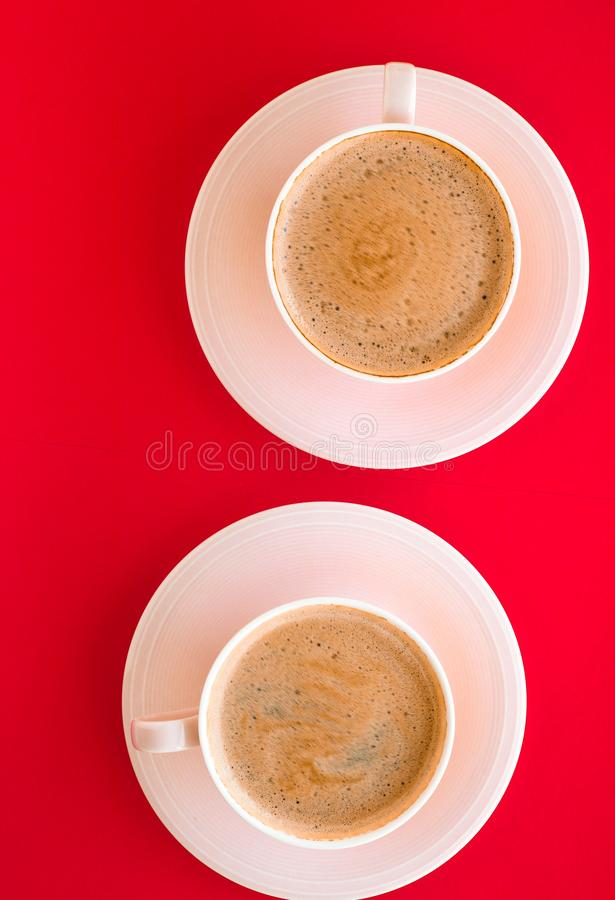 Hot aromatic coffee on red background, flatlay. Breakfast, drinks and modern lifestyle concept - Hot aromatic coffee on red background, flatlay royalty free stock photography