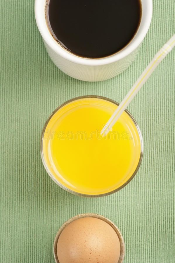 Breakfast with egg, orange juice and coffee stock image