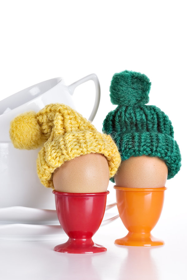 Breakfast Eggs. In a Eggcup on white royalty free stock image