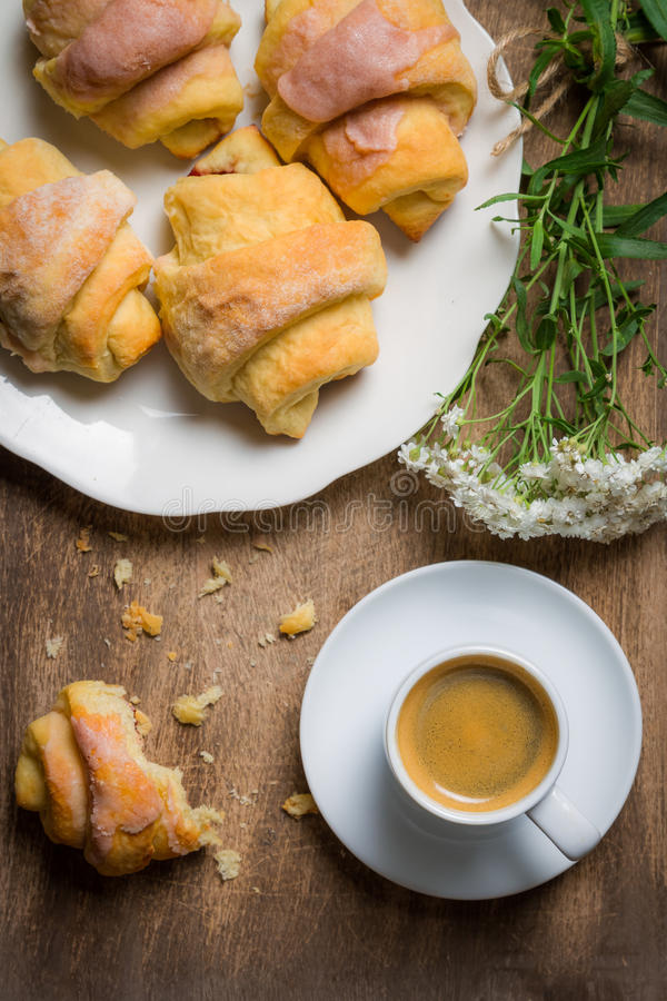 Breakfast with espresso and a croissant stock photography