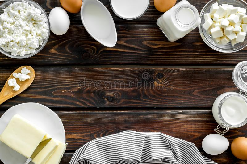 Breakfast on farm with dairy products frame on wooden background top view space for text royalty free stock photo