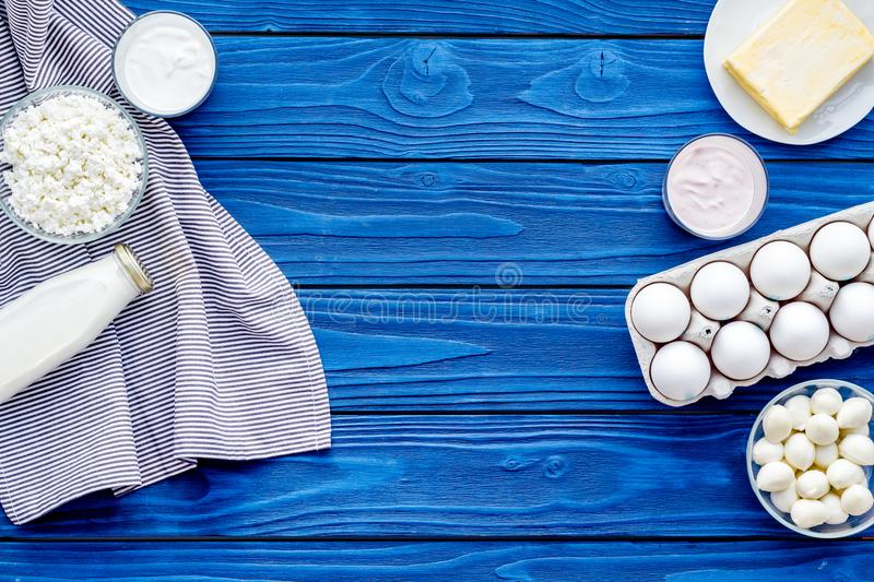 Breakfast on farm with dairy products. Milk, cottage, cheese, yougurt on blue table top view mock-up stock photos
