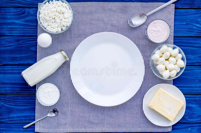 Breakfast on farm with dairy products. Milk, cottage, cheese, yougurt on blue table top view mock-up stock photography
