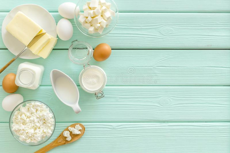Breakfast on farm with dairy products on mint green wooden background top view space for text royalty free stock photography