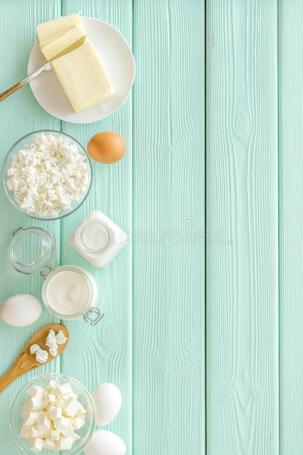 Breakfast on farm with dairy products on mint green wooden background top view space for text stock photography