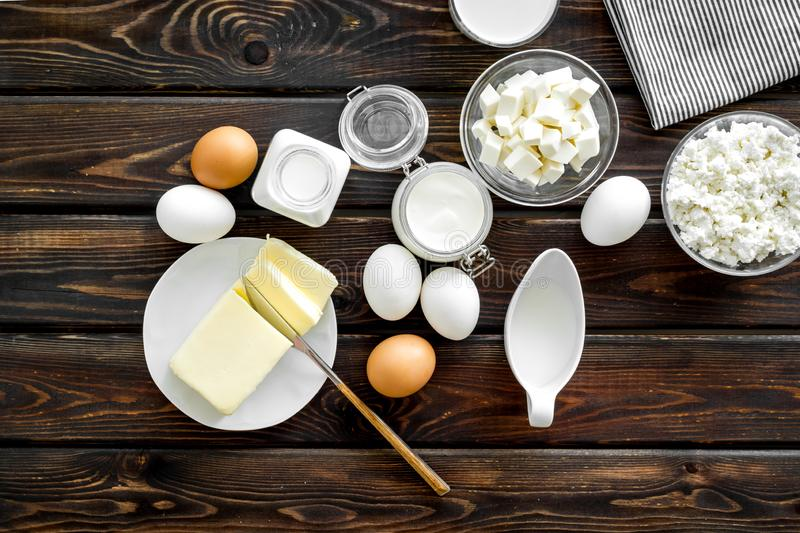 Breakfast on farm with dairy products on wooden background top view royalty free stock image