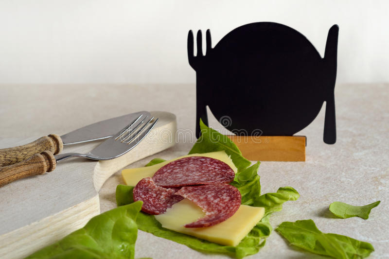 Breakfast food photography with space for text. Breakfast with salami, cheese and salad on rustic background royalty free stock photo