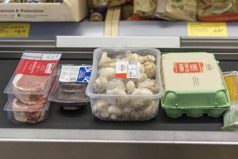 Breakfast food in supermarket. Breakfast food on a supermarket conveyor belt royalty free stock images