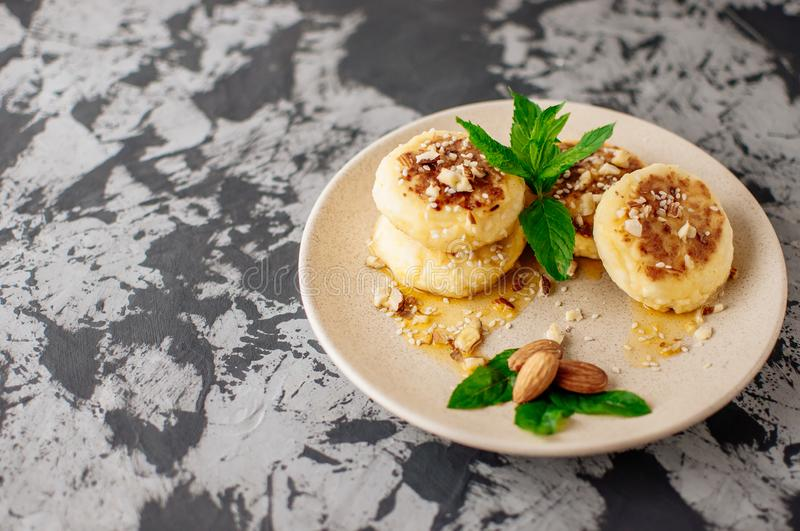 Homemade traditional Ukrainian and Russian cheesecakes, top view.Healthy food royalty free stock images