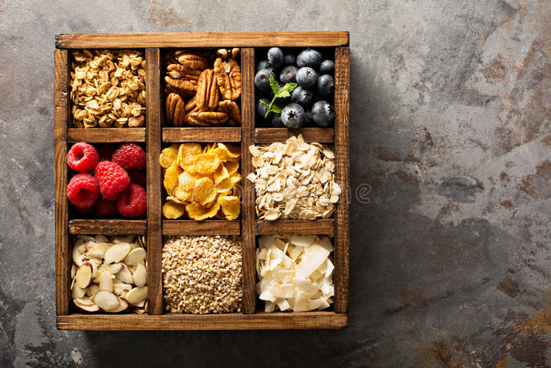 Breakfast foods in a wooden box overhead shot. Breakfast foods, oats, cereals and fruit in a wooden box overhead shot stock photos