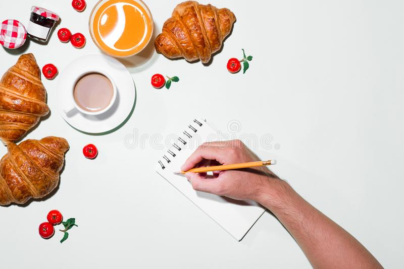 Breakfast with fresh croissants and orange juice, top view.  stock photos
