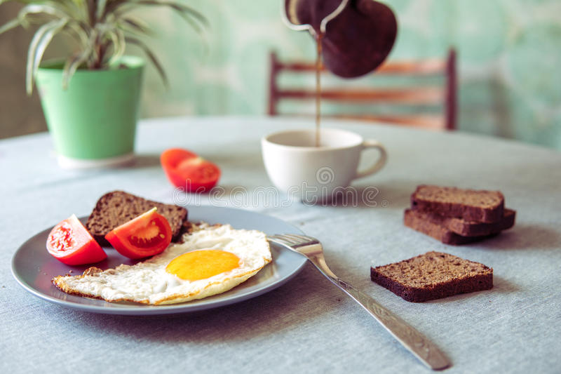 Breakfast fried egg and tomatoes.Coffee from cezve royalty free stock photo