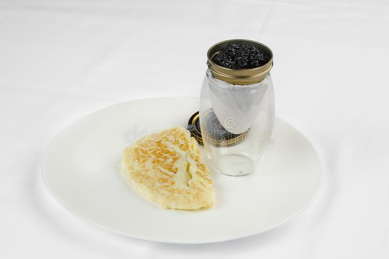 Breakfast granny. Omelette with black caviar. royalty free stock photography