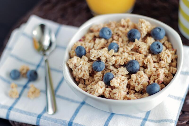 Breakfast granola with blueberries royalty free stock photo