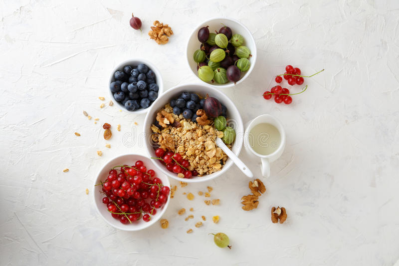 Breakfast granola in bowl with berries. Food top view royalty free stock photos