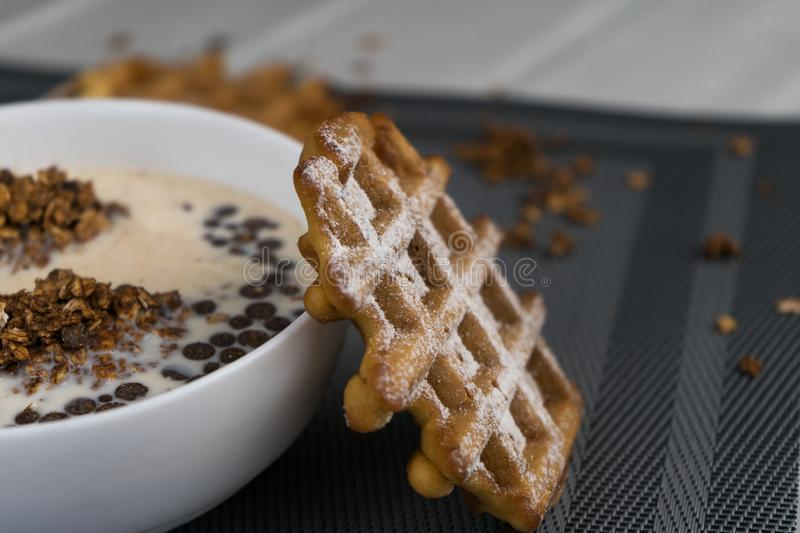 Breakfast - granola with soy milk and waffles stock image
