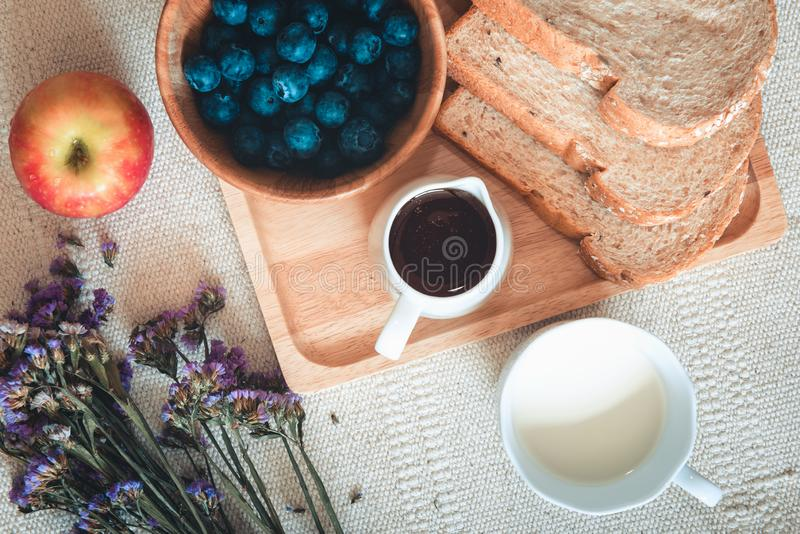 Breakfast Healthy Food With Coffee, Milk, Whole Wheat Bread, Honey and Fresh Fruits on The Table., Delicious Menu in The Morning, stock image
