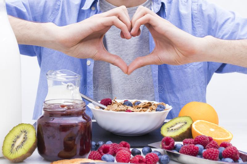 Breakfast and healthy food. Heart-shaped hands with breakfast and healthy food royalty free stock image