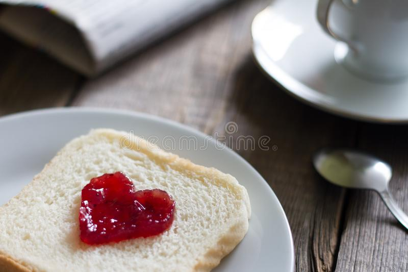 Breakfast with heart shape jam on bread food abstract concept still life. Closeup royalty free stock photography