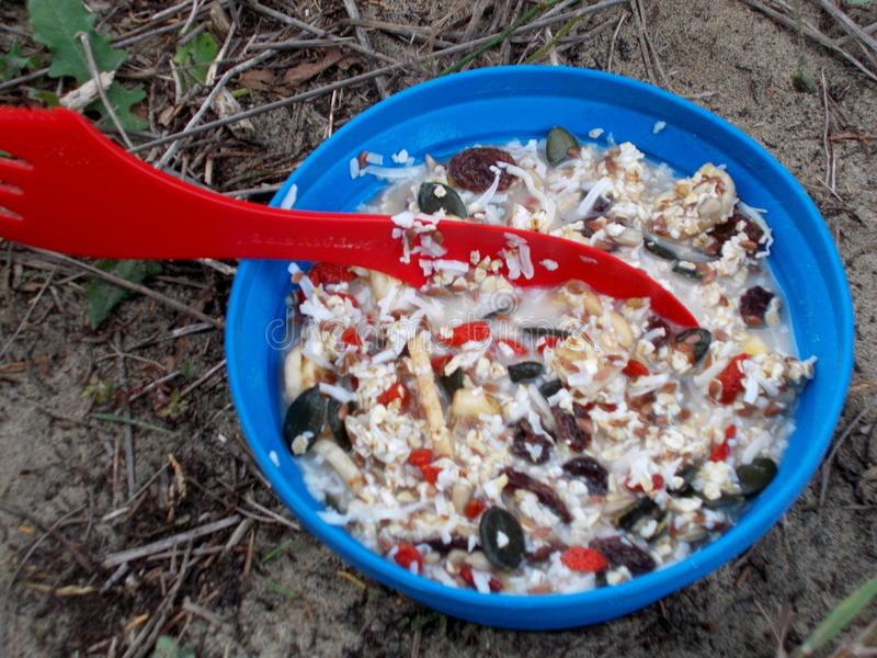 Breakfast on a hiking trail at ninety mile beach new zealand. Bowl of healthy breakfast on a hiking trail at ninety mile beach new zealand stock images