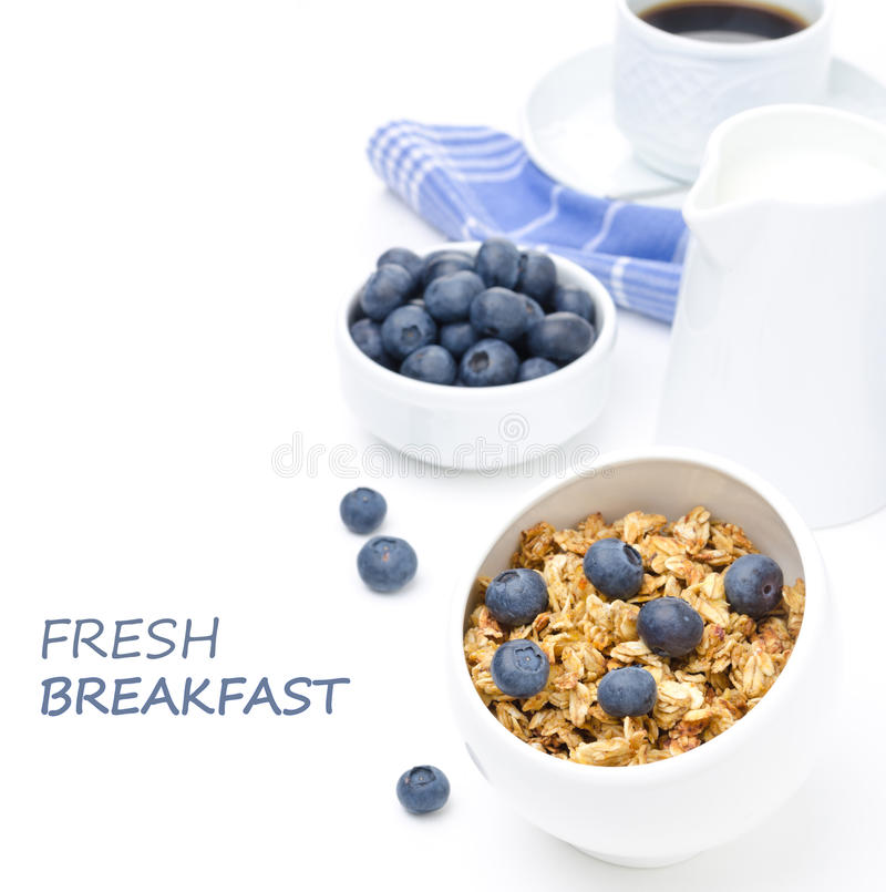 Breakfast with homemade granola, blueberries and black coffee. Isolated on a white background stock photos