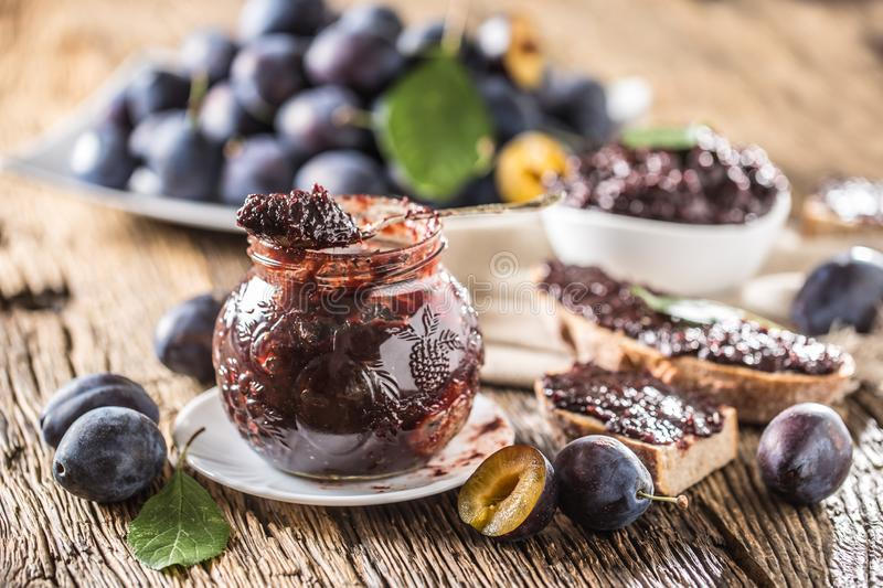 Breakfast from homemade plum jam bread and ripe plums. stock photo