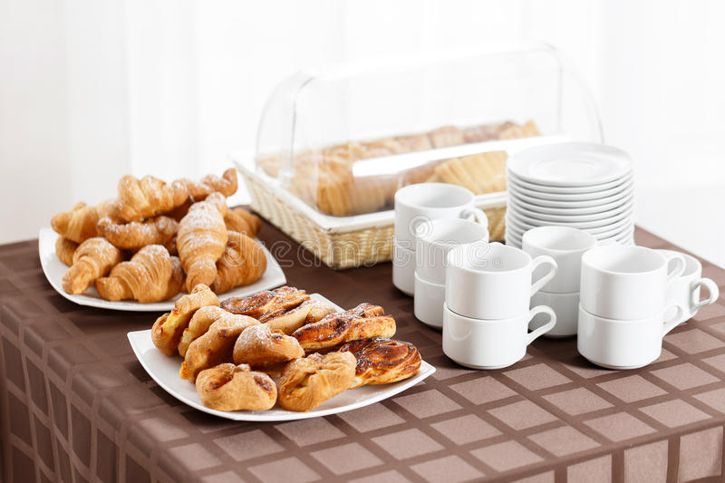 Breakfast at the hotel. croissants and puff in the foreground. selective focus stock photos