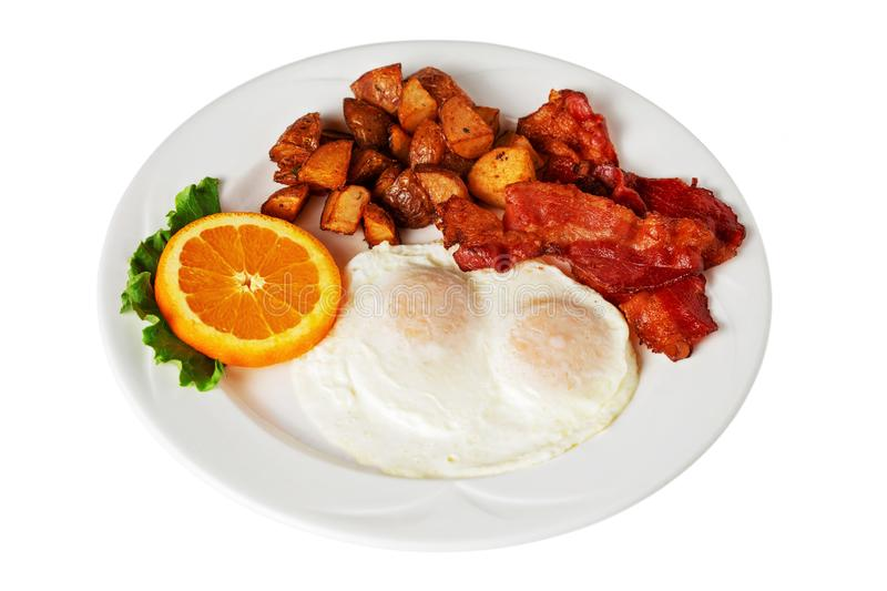 bacon and fried eggs breakfast isolated on white stock image