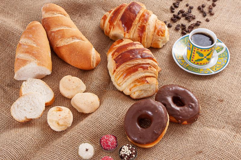 Breakfast with Italian bread, cheese bread, chocolate donut, coffee and croissant.  royalty free stock photos