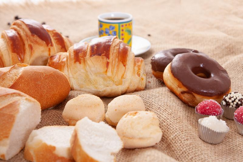 Breakfast with Italian bread, cheese bread, chocolate donut, coffee and croissant.  royalty free stock photography