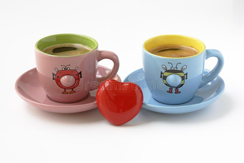 Breakfast and love. Funnies coffee cups about breakfast in love stock photography