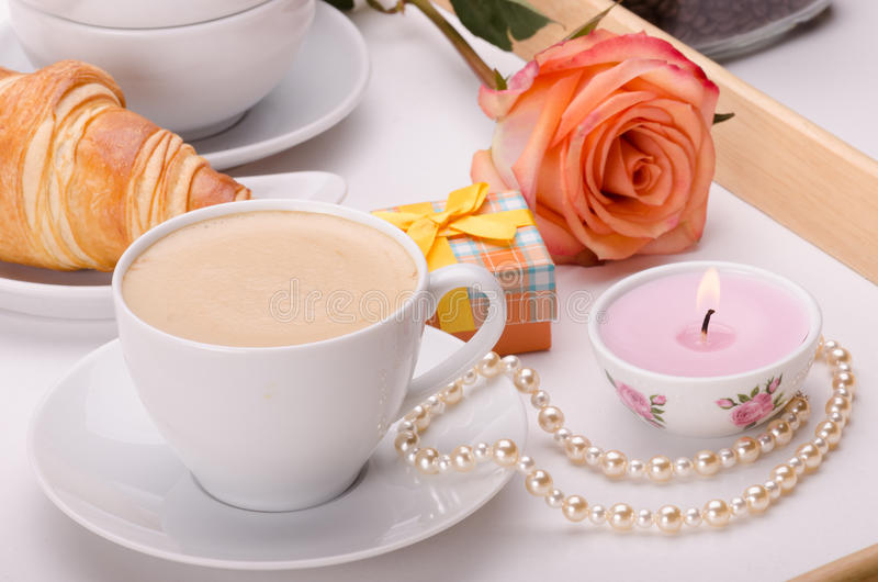Breakfast with love. Breakfast on wooden tray with genuine pearls, present box and a rose stock images