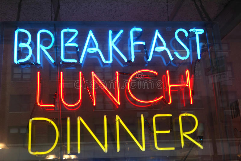 Breakfast Lunch Dinner. A neon sign that reads Breakfast Lunch Dinner stock images