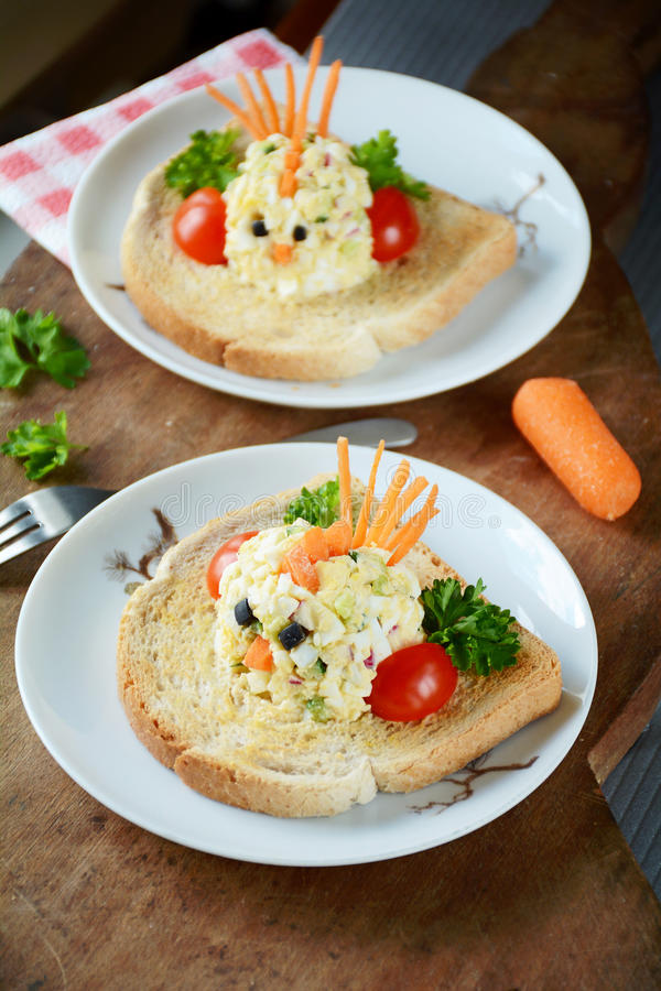 Breakfast or lunch for kids. Funny toast for kids breakfast: chicken shaped egg salad on toasted white american bread stock images